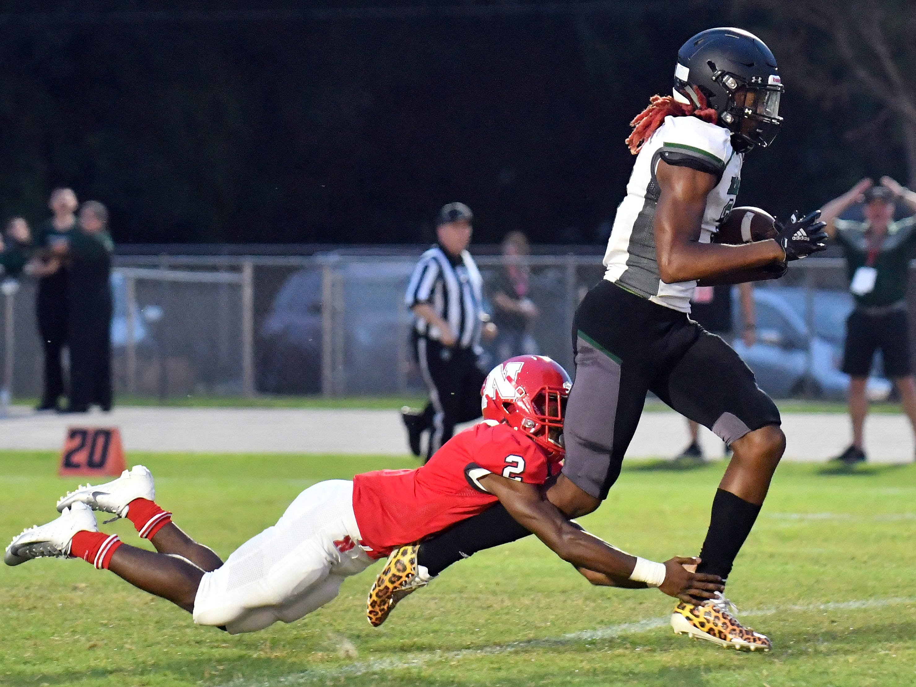 Palmetto Ridge High School Kamonte Grimes (3) catches a pass over Tyrone Campbell (2) of North Fort Myers High School, Friday, Sept. 7, 2018. (Chris Tilley/Special to the Naples Daily News)
