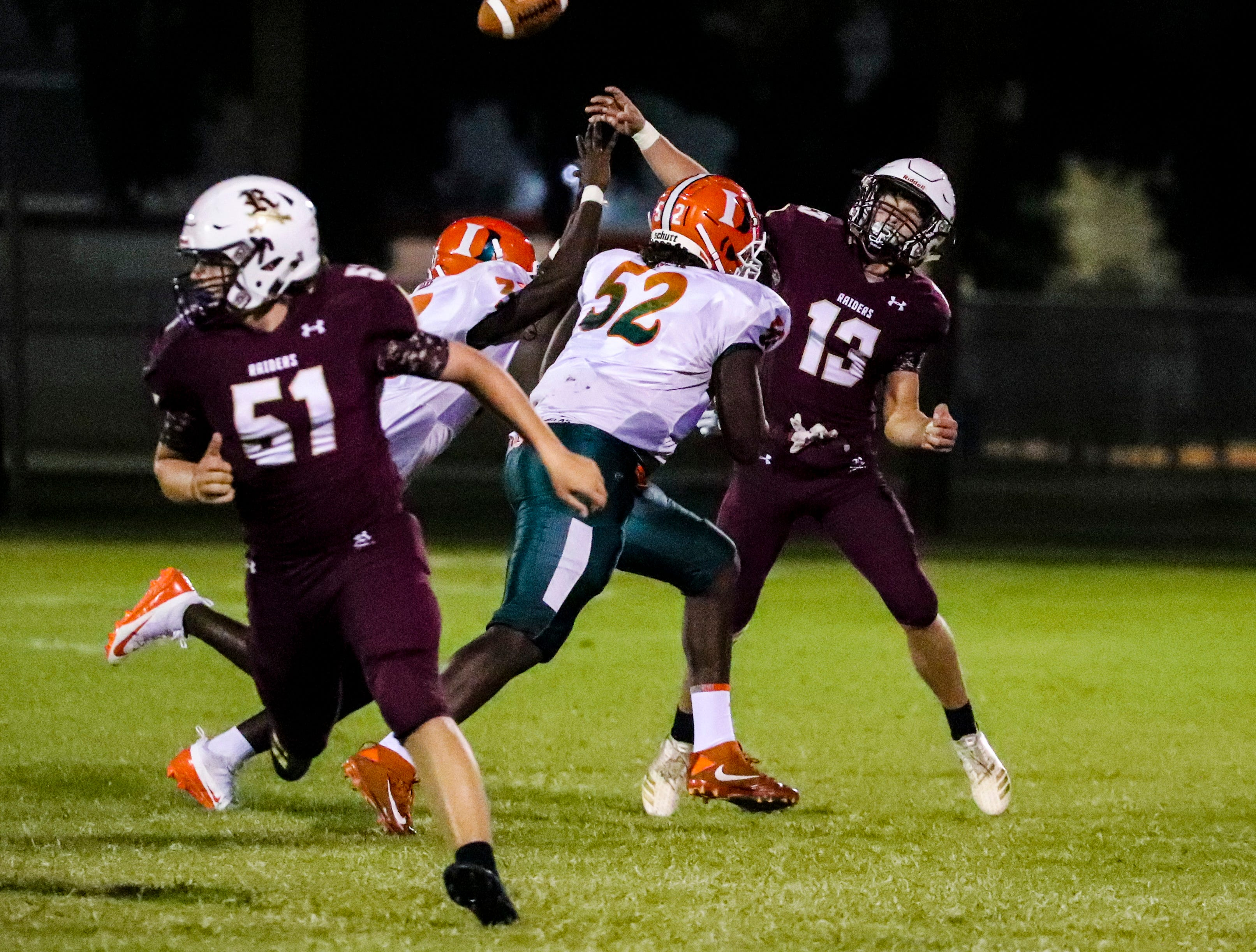 Riverdale QB Dylan Ulmer releases the pass under heavy pressure of Dunbar defense. Images from the Dunbar at Riverdale high school football game, Friday, September 8th, 2018.