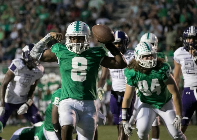 Fort Myers quarterback Willie Neal celebrates a touchdown in the first half against Cypress Lake on Friday, September 7, 2018, at Fort Myers High School.