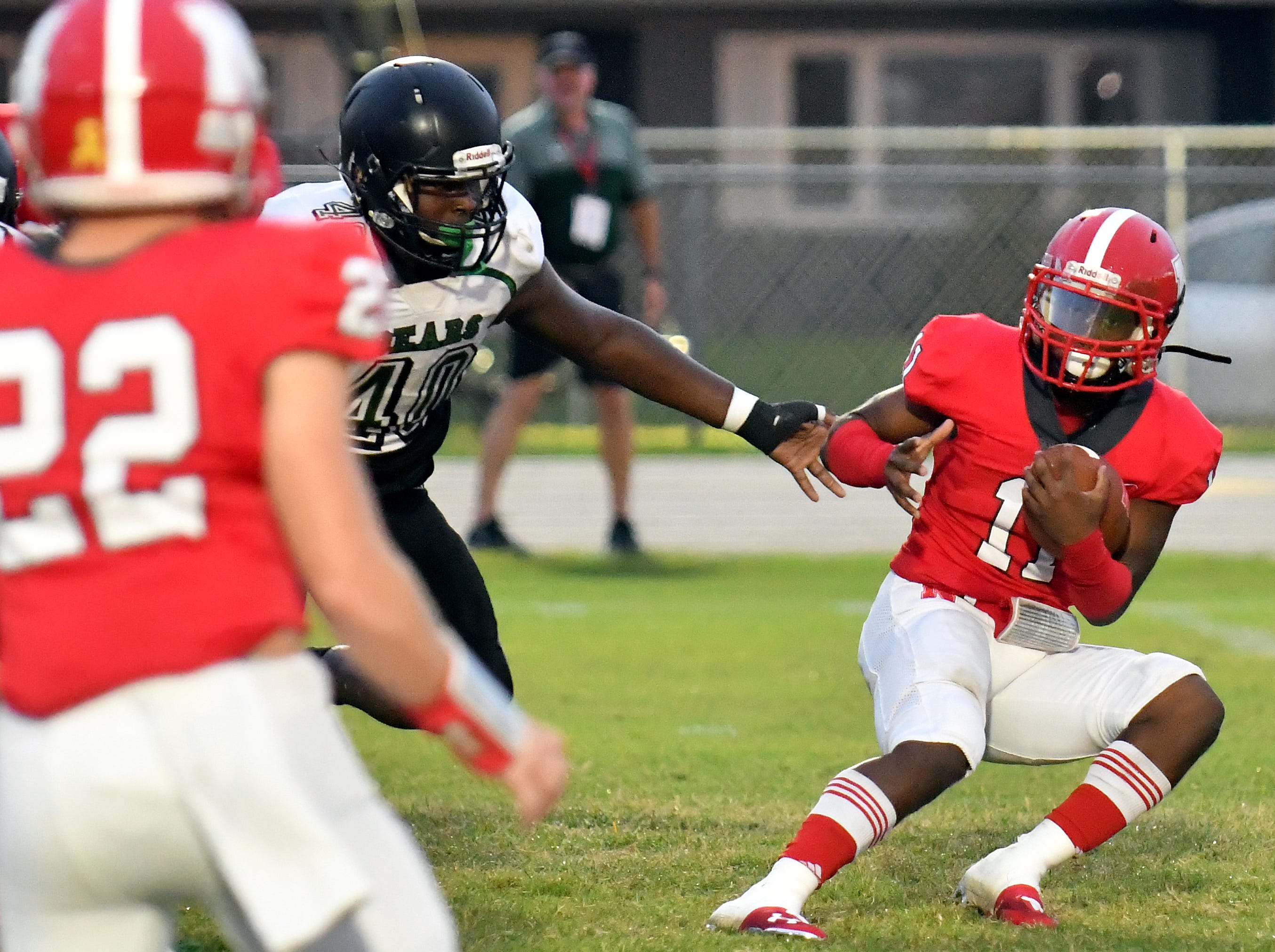 North Fort Myers High School running back Shomari Manson (11) dodges a defender during their game with Palmetto Ridge High School, Friday, Sept. 7, 2018. (Chris Tilley/Special to the Naples Daily News)