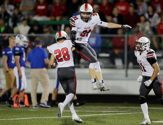Pulaski's Logan Lukasik (31) celebrates after intercepting a pass against Notre Dame in a high school football game at Notre Dame Academy on Friday, September 7, 2018 in Green Bay, Wis.