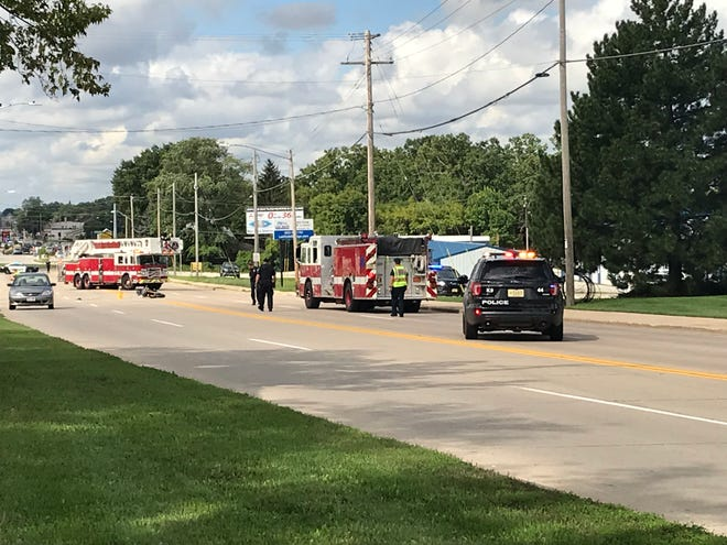 Authorities respond to a fatal crash involving a motorcycle Saturday morning on University Avenue.