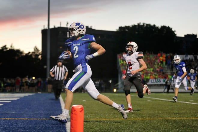 Notre Dame's Tommy Martzahl (2) scores a touchdown against Pulaski in a high school football game at Notre Dame Academy on Friday, September 7, 2018 in Green Bay, Wis.