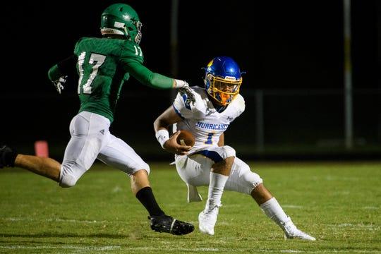 Wren quarterback Tyrell Jackson (1) attempts to evade Easley's Dawson Wilson (17) on Friday, Sept. 7, 2018.