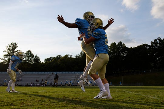 D.W. Daniel warm up before their game against Westside at Daniel on Friday, Sept. 7, 2018.