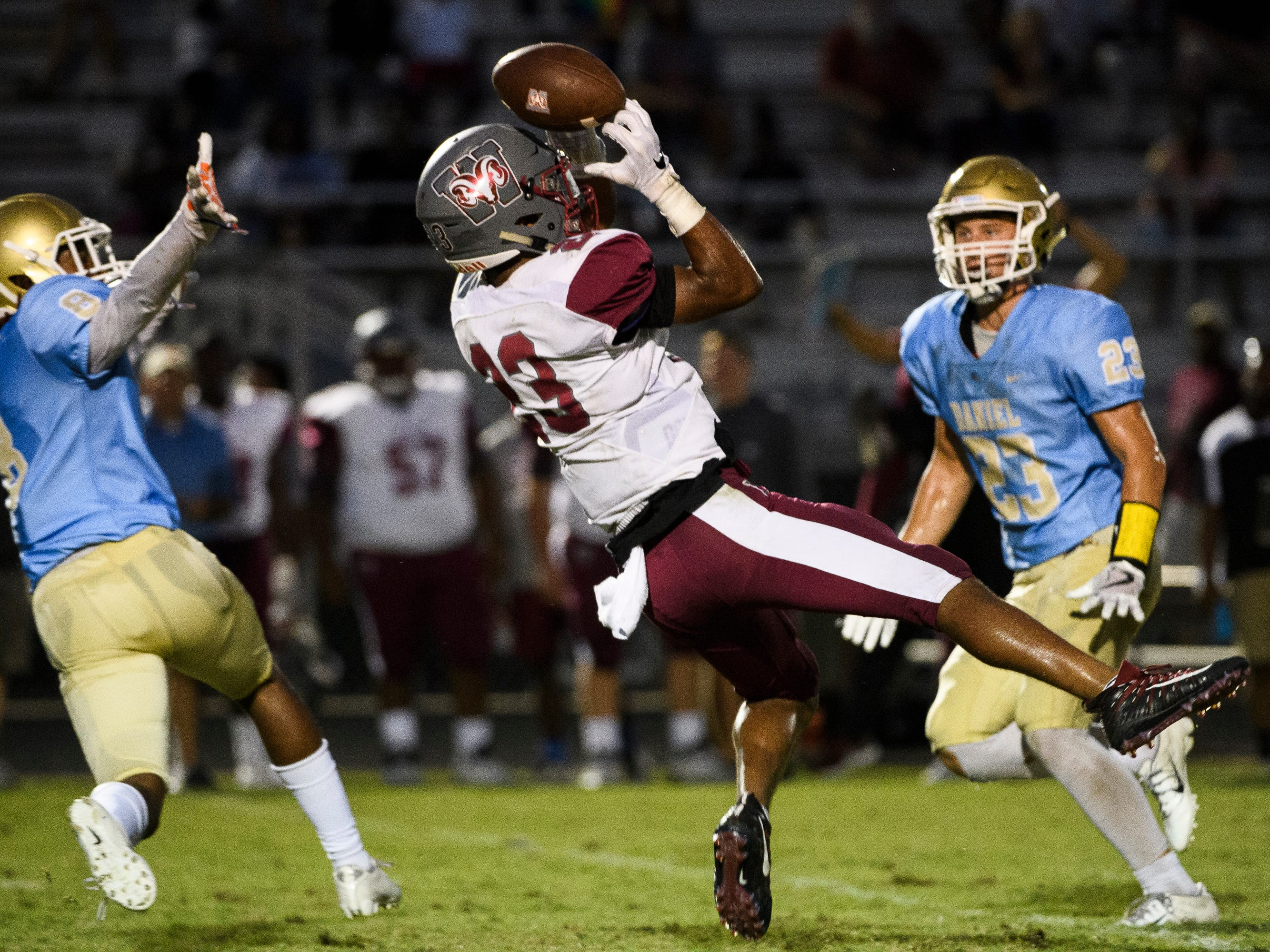Westside's Tyson Lewis (13) attempts to catch the ball during their game against D.W. Daniel on Friday, Sept. 7, 2018.