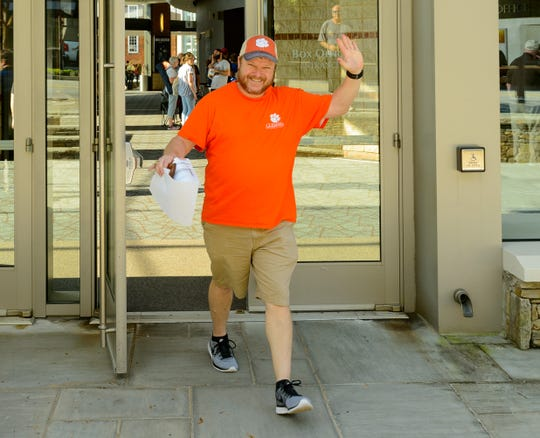 Jackson Smith of Greenville is the first person to exit the Peace Center box office with Hamilton tickets in hand on Saturday, September 8, 2018 in downtown Greenville.