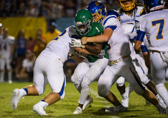 Easley's Jeremy Harried (1) is taken down by Wren defense on Friday, Sept. 7, 2018.