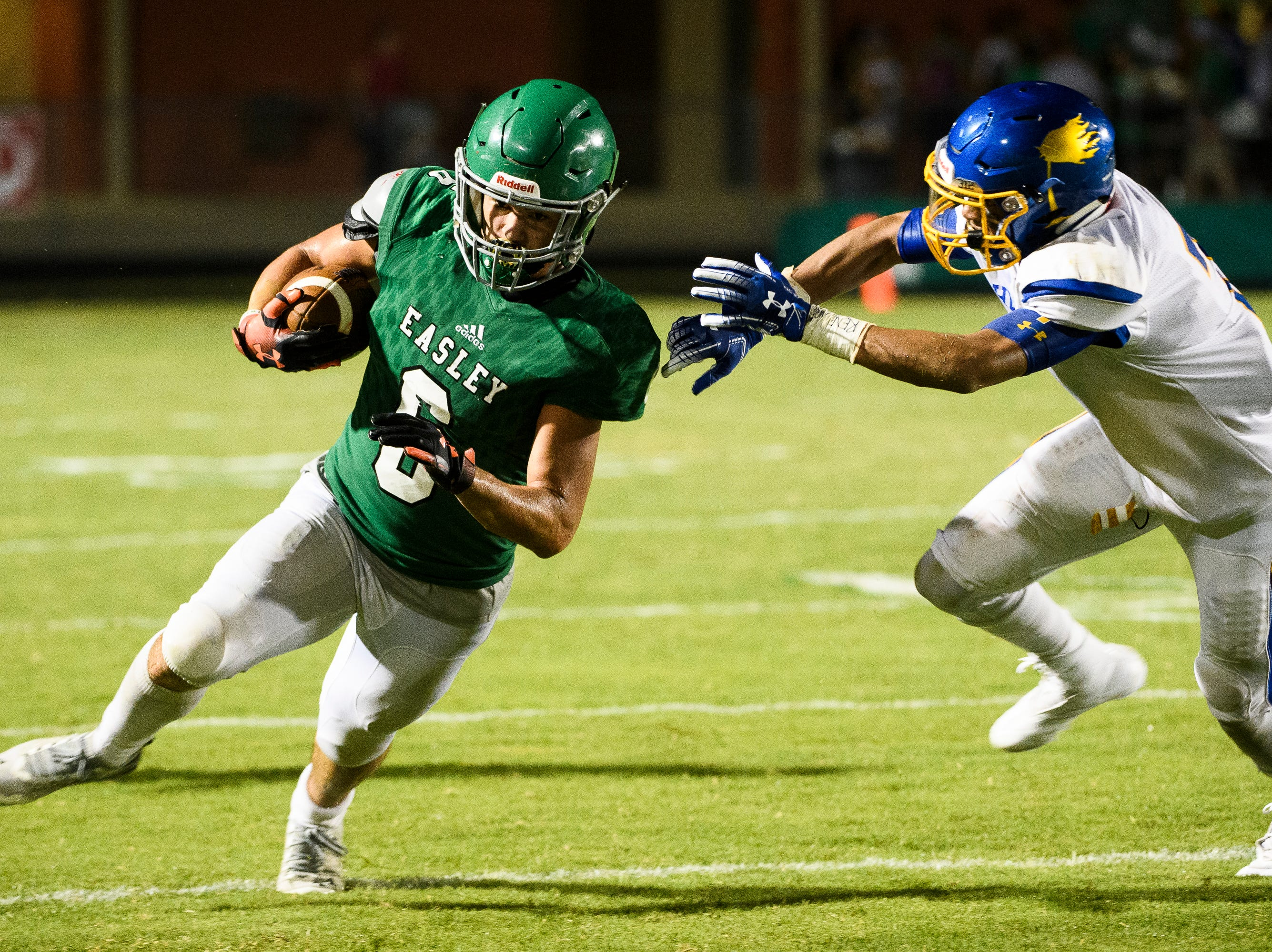 Easley's Dylan Lyda (6) attempts to evade Wren's Anthony Goodwin (7) on Friday, Sept. 7, 2018.