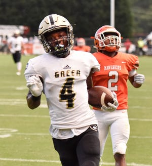Cameron Martin (4) scores a touchdown for Greer in its 40-3 win over Mauldin at Freeman Field Friday night. Martin had five catches for 122 yards and two scores.