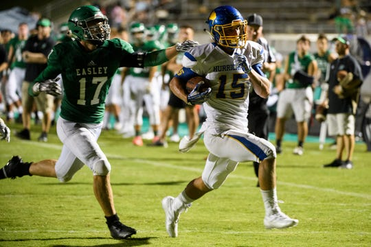 Wren's Tyler Cherry (15) evades Easley's Dawson Wilson (17) and scores a touchdown on Friday, Sept. 7, 2018.