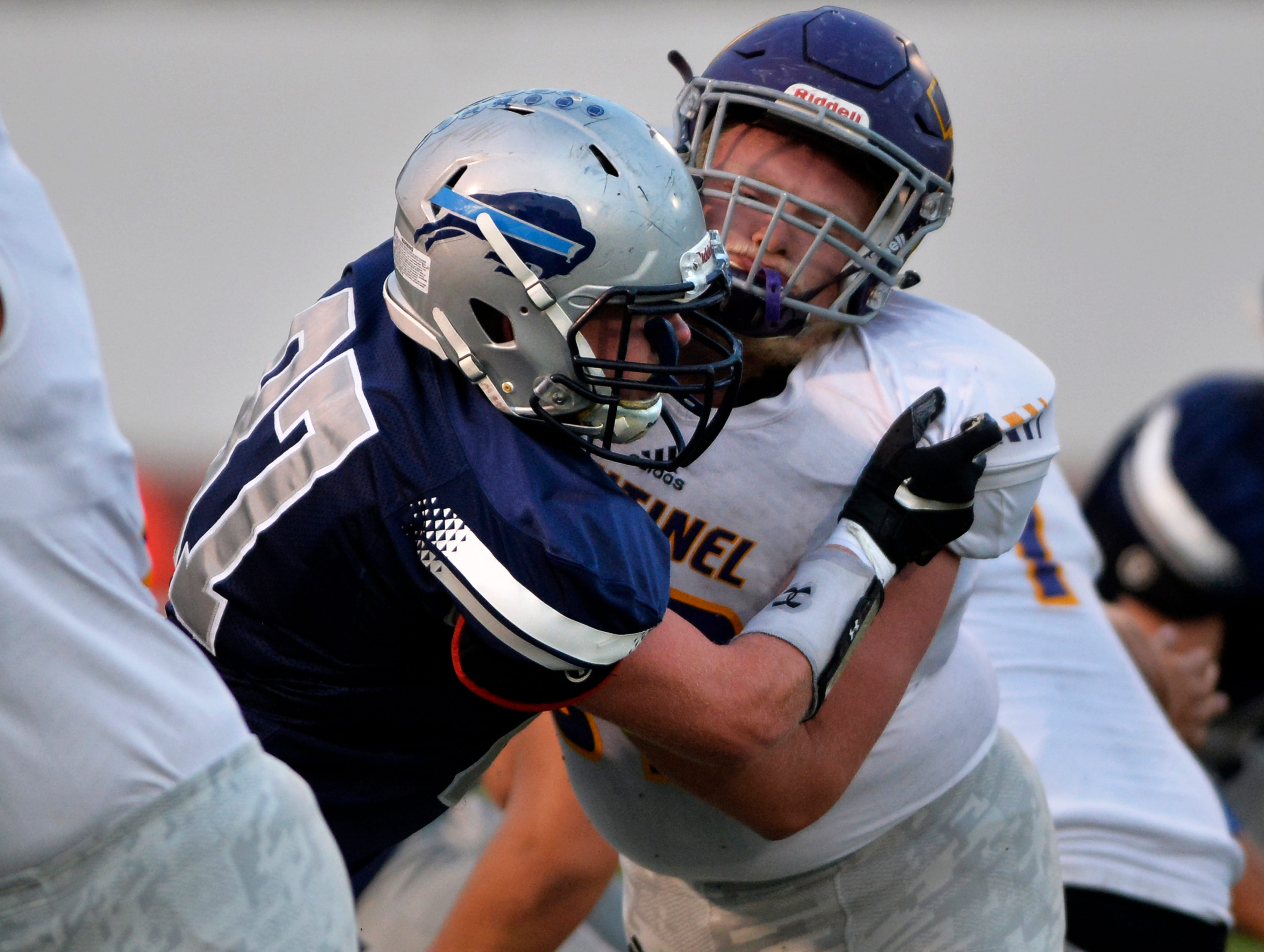 Great Falls High's Lane Vandermars engages a Missoula Sentinel blocker on his way to the quarterback in Friday night's football game at Memorial Stadium, Sept. 7, 2018.