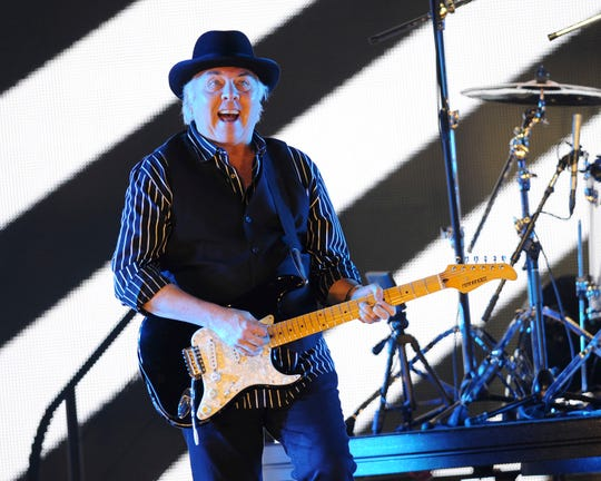 FILE - In this May 24 2013, file photo, Gene Cornish, of The Rascals, performs at Hard Rock Live! in the Seminole Hard Rock Hotel & Casino in Hollywood, Fla. A theater official says Rock & Roll Hall of Fame guitarist Gene Cornish of The Rascals collapsed on stage while performing in Montana. The Billings Gazette reports the 74-year-old Cornish was taken to a hospital after the incident Friday, Sept. 7, 2018. There was no immediate word on his condition. (Photo by Jeff Daly/Invision/AP)