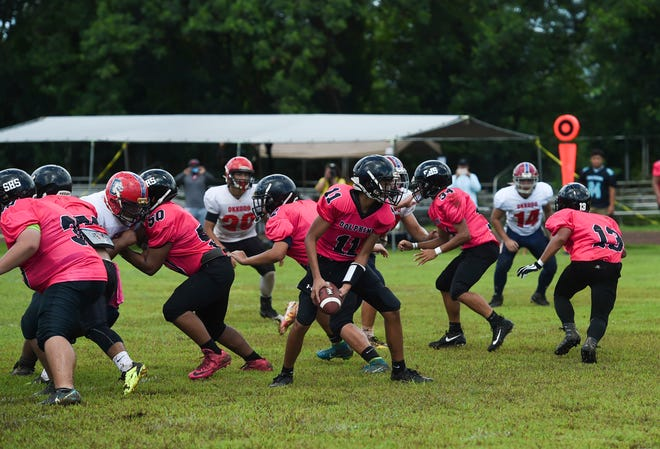 The Okkodo Bulldogs are shown in an IIAAG High School Football game at the Southern High's field in this Sept. 8 file photo.