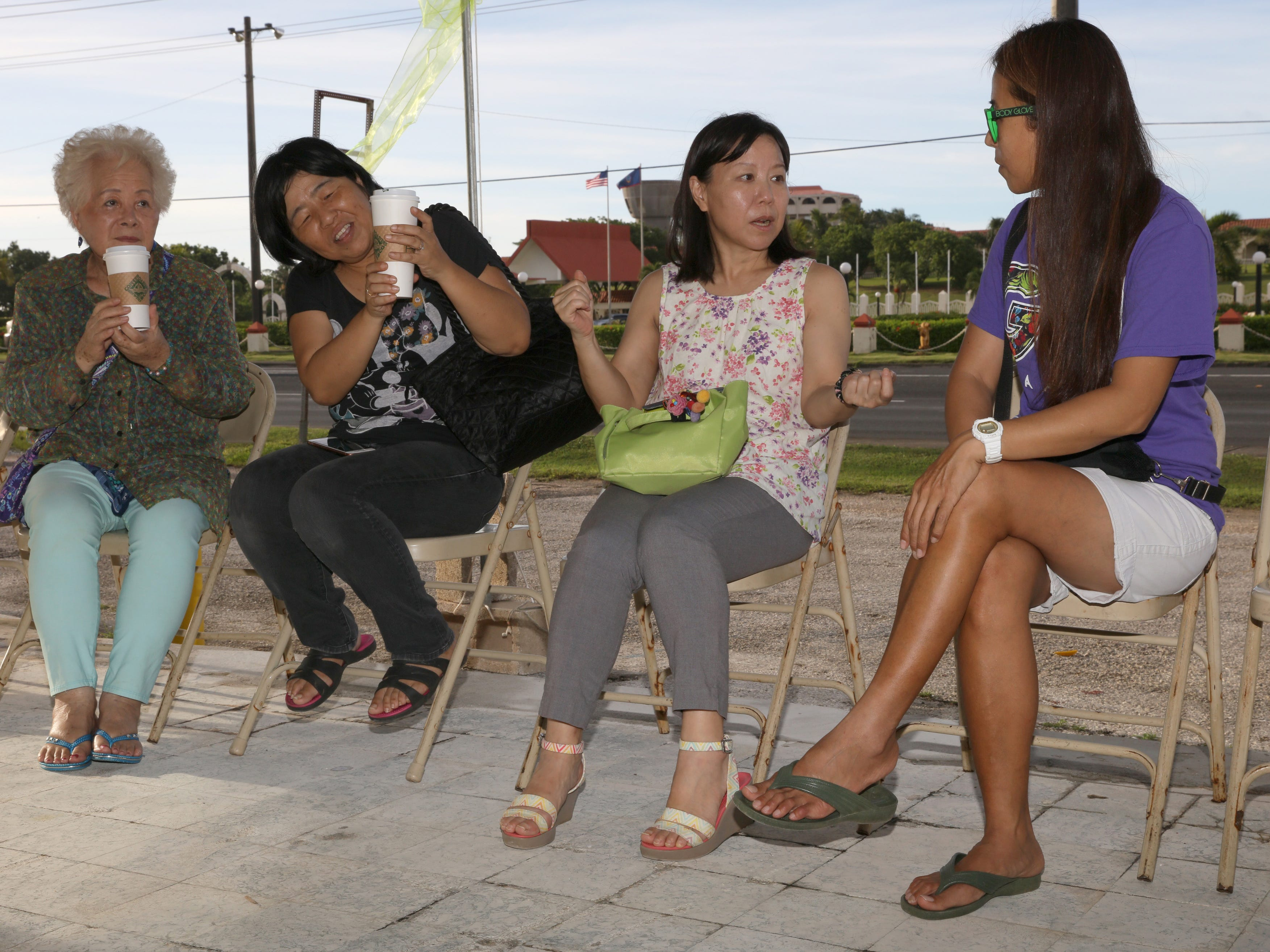 Customers enjoy their coffee at the Sling Stone Coffee grand opening in Anigua.