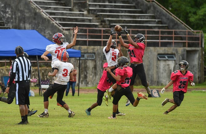 Southern High player Gabriel Stanley (21) attempts to make an interception against the Okkodo Bulldogs during their IIAAG High School Football game at the Southern High School Football Field on Sept. 8, 2018.