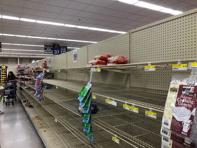 Residents clear out store shelves on Sept. 8 2018 in preparation for Typhoon Mangkhut.