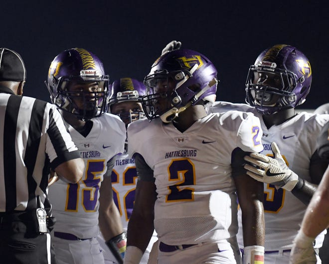 Hattiesburg High quarterback Jarod Conner celebrates with his teammates after a tourhdown in a game against Oak Grove on Friday, September 7, 2018.