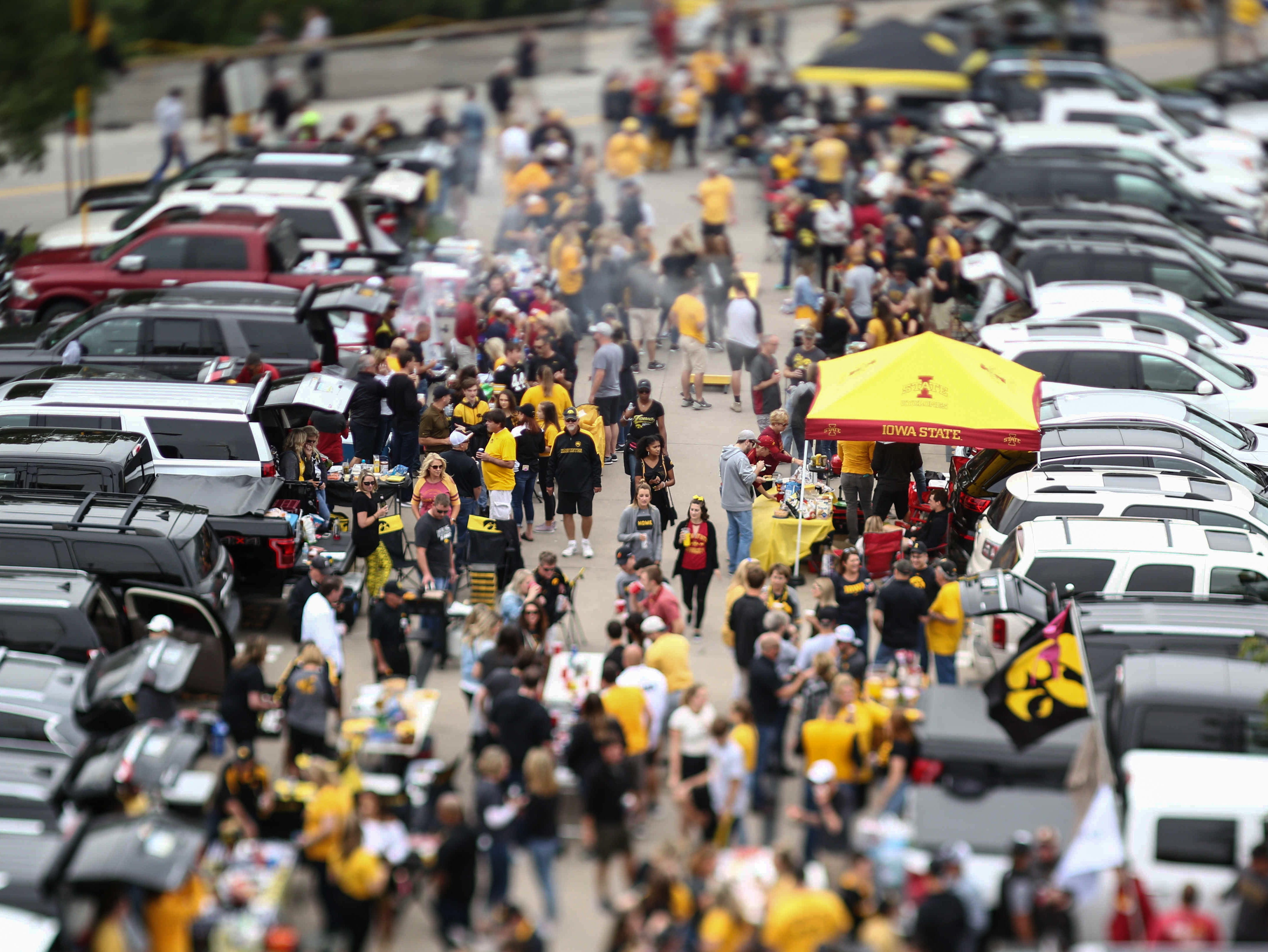 Tailgaters mill about the grounds of Kinnick Stadium during the Cy-Hawk game on Saturday, Sept. 8, 2018, in Iowa City.
