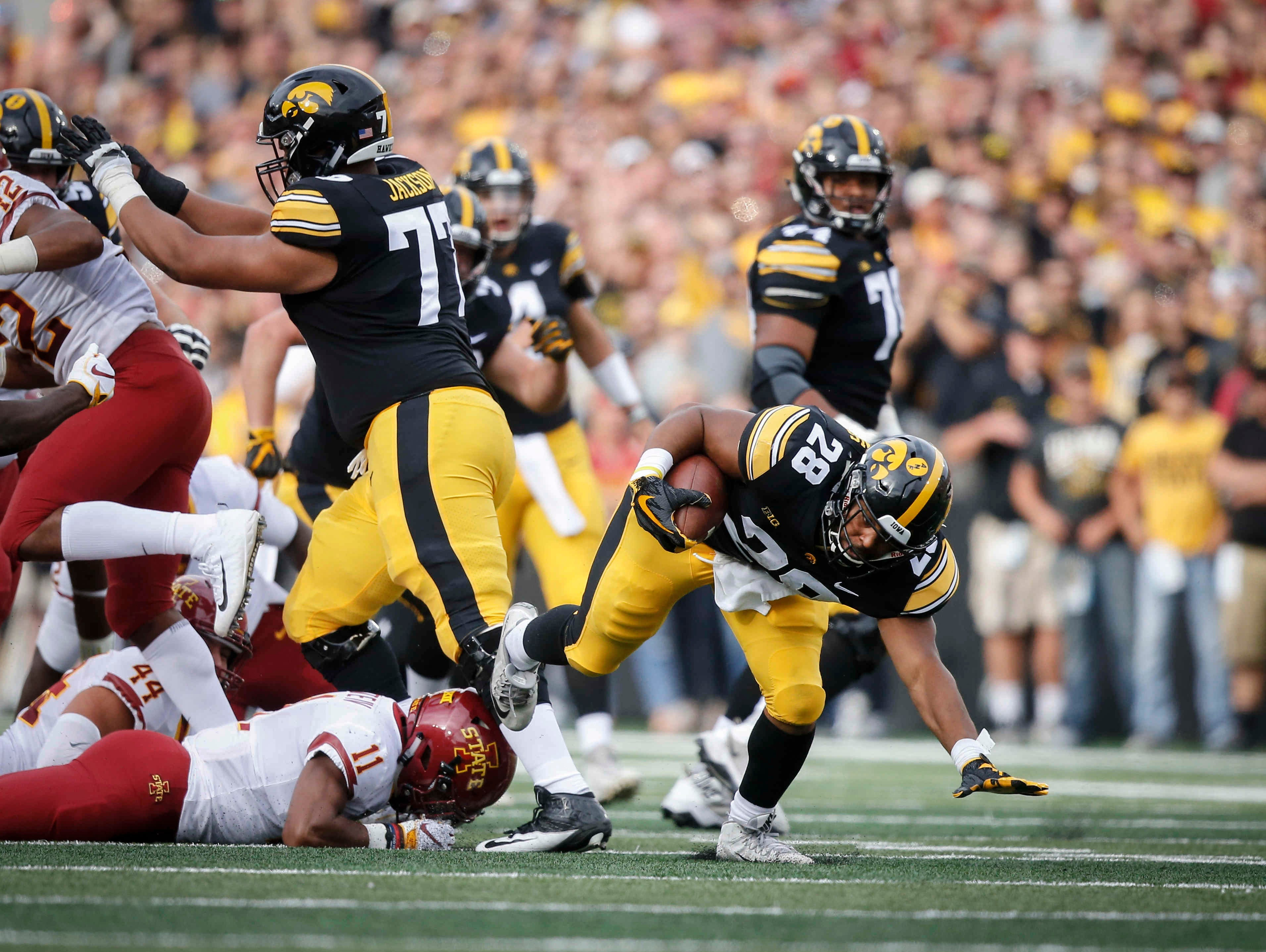Iowa running back Toren Young runs the ball up the middle against Iowa State on Saturday, Sept. 8, 2018, at Kinnick Stadium in Iowa City.