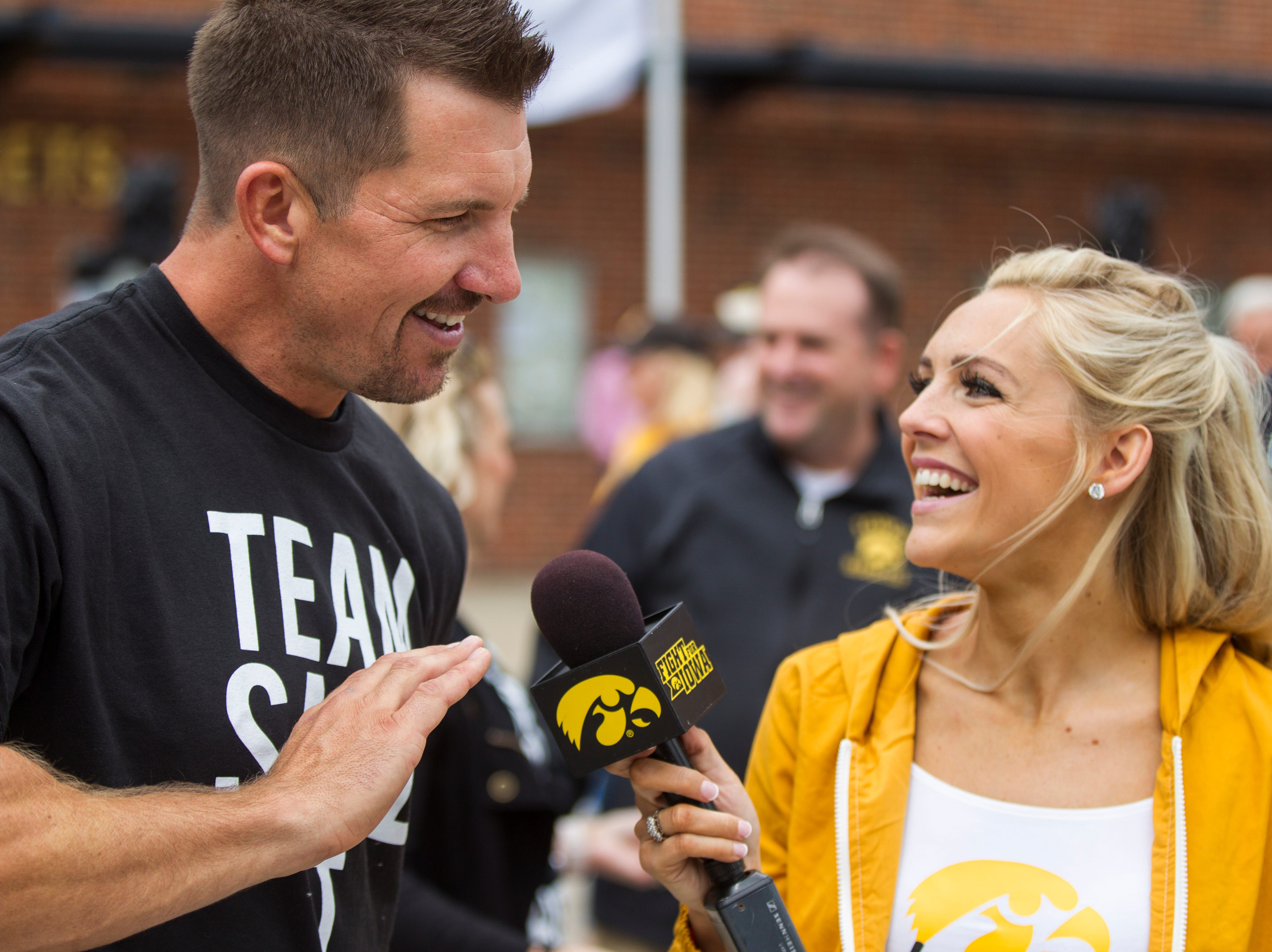 Dallas Clark speaks with Laura VandeBerg before the Cy-Hawk NCAA football game on Saturday, Sept. 8, 2018, at Kinnick Stadium in Iowa City.