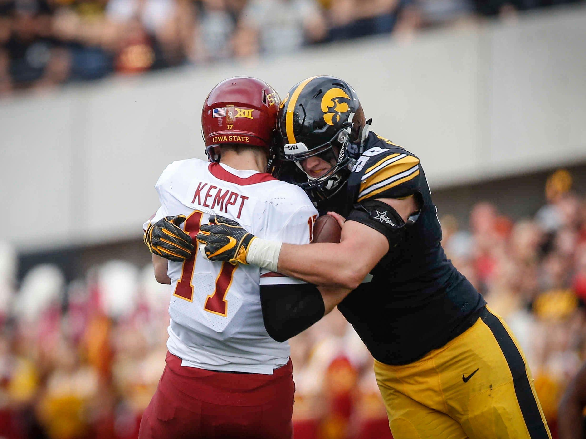 Iowa right tackle Matt Nelson sacks Iowa State quarterback Kyle Kempt in the second quarter on Saturday, Sept. 8, 2018, at Kinnick Stadium in Iowa City.