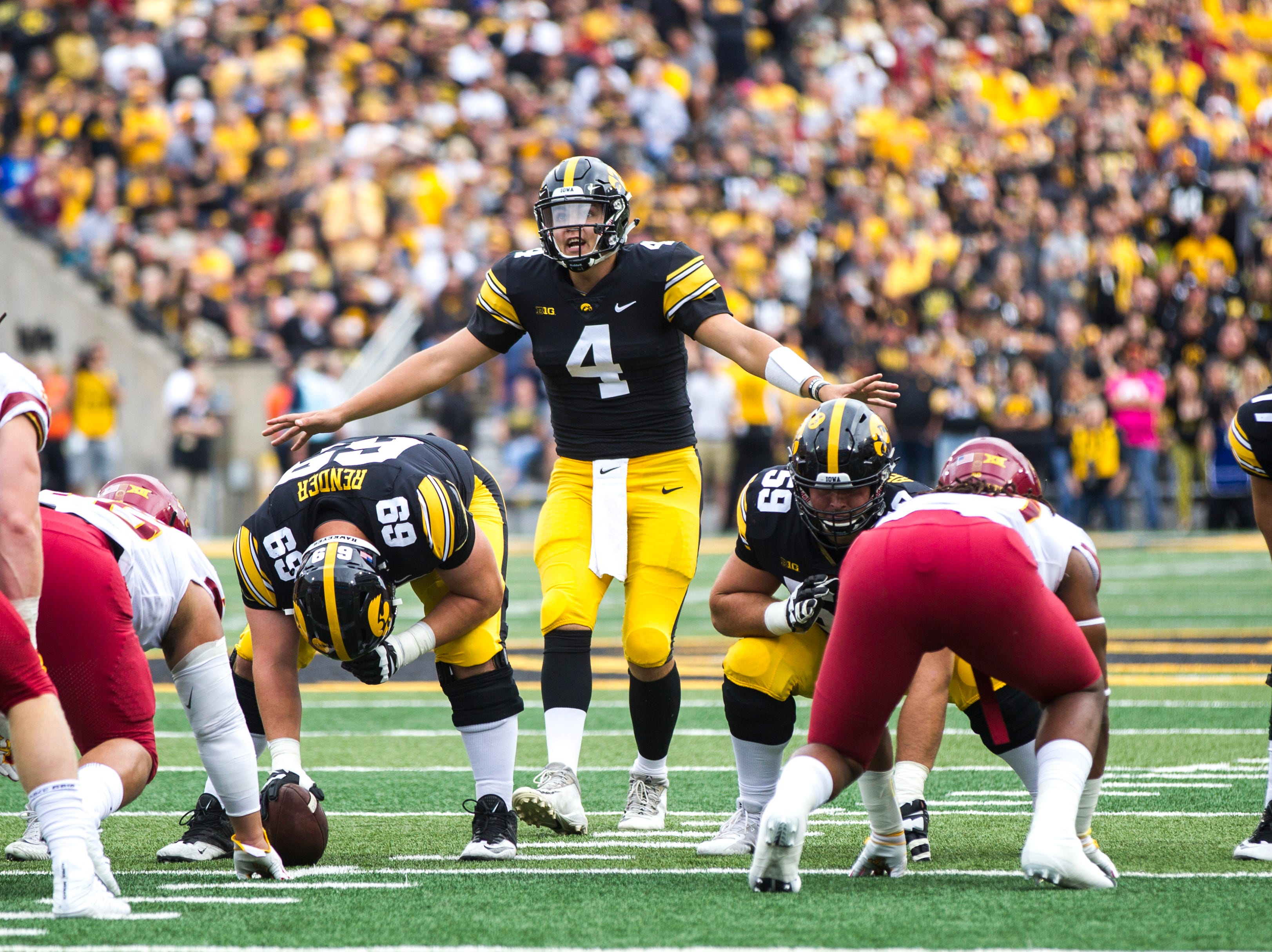 Iowa quarterback Nate Stanley (4) calls to teammates at the line during the Cy-Hawk NCAA football game on Saturday, Sept. 8, 2018, at Kinnick Stadium in Iowa City.
