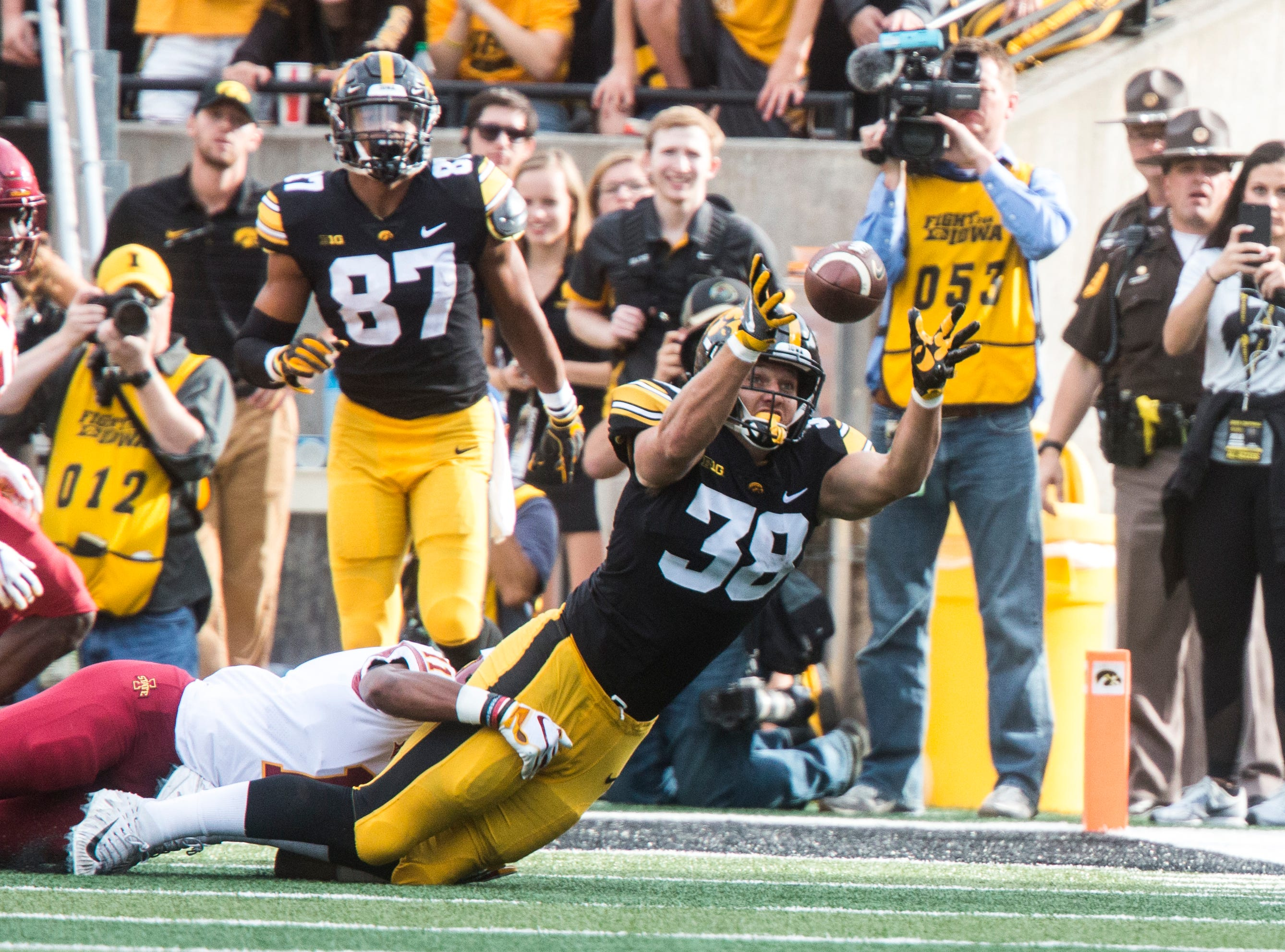 Iowa tight end T.J. Hockenson (38) attempts to catch a tipped pass during the Cy-Hawk NCAA football game on Saturday, Sept. 8, 2018, at Kinnick Stadium in Iowa City.