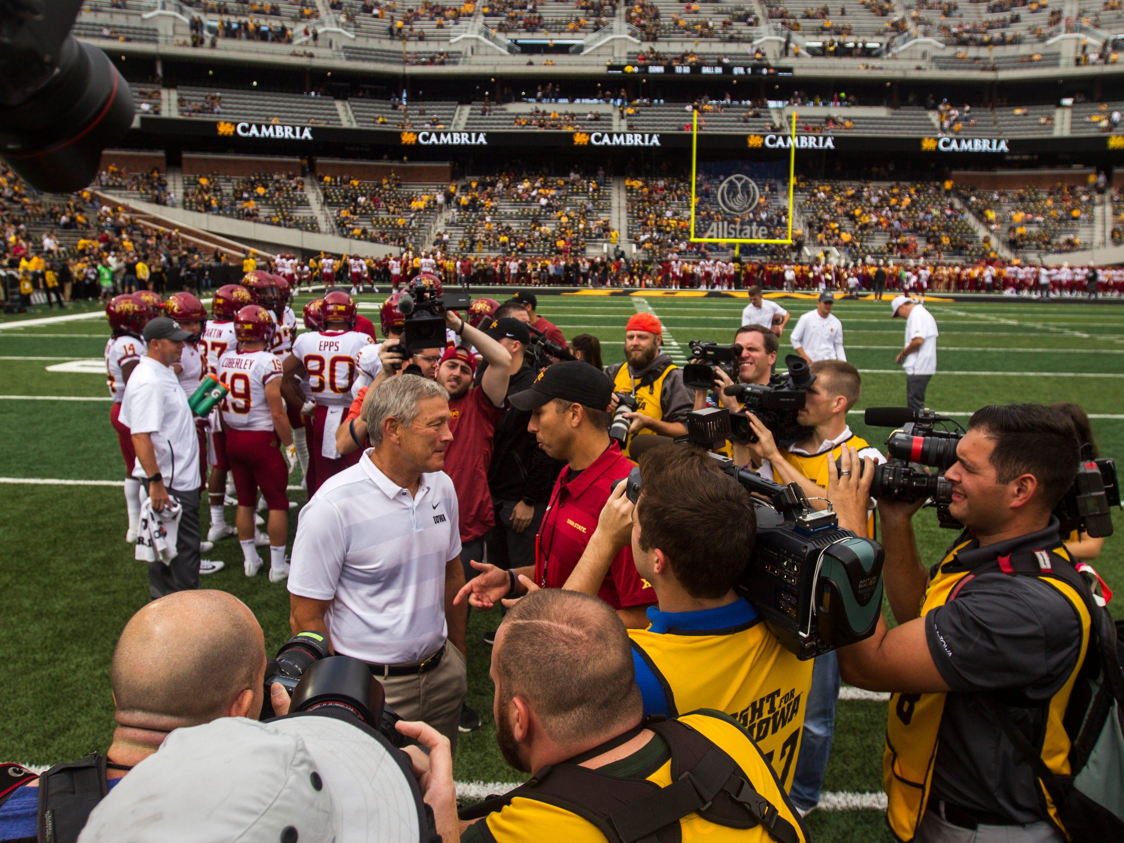 Iowa head coach Kirk Ferentz and Iowa State head coach Matt Campbell meet a midfield before the Cy-Hawk NCAA football game on Saturday, Sept. 8, 2018, at Kinnick Stadium in Iowa City.