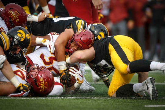 Iowa State running back David Montgomery is drilled by a host of Iowa defenders in the second quarter on Saturday, Sept. 8, 2018, at Kinnick Stadium in Iowa City.