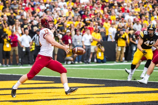 Iowa State punter Corey Dunn kicks out of the end zone during the Cy-Hawk NCAA football game on Saturday, Sept. 8, 2018, at Kinnick Stadium in Iowa City.