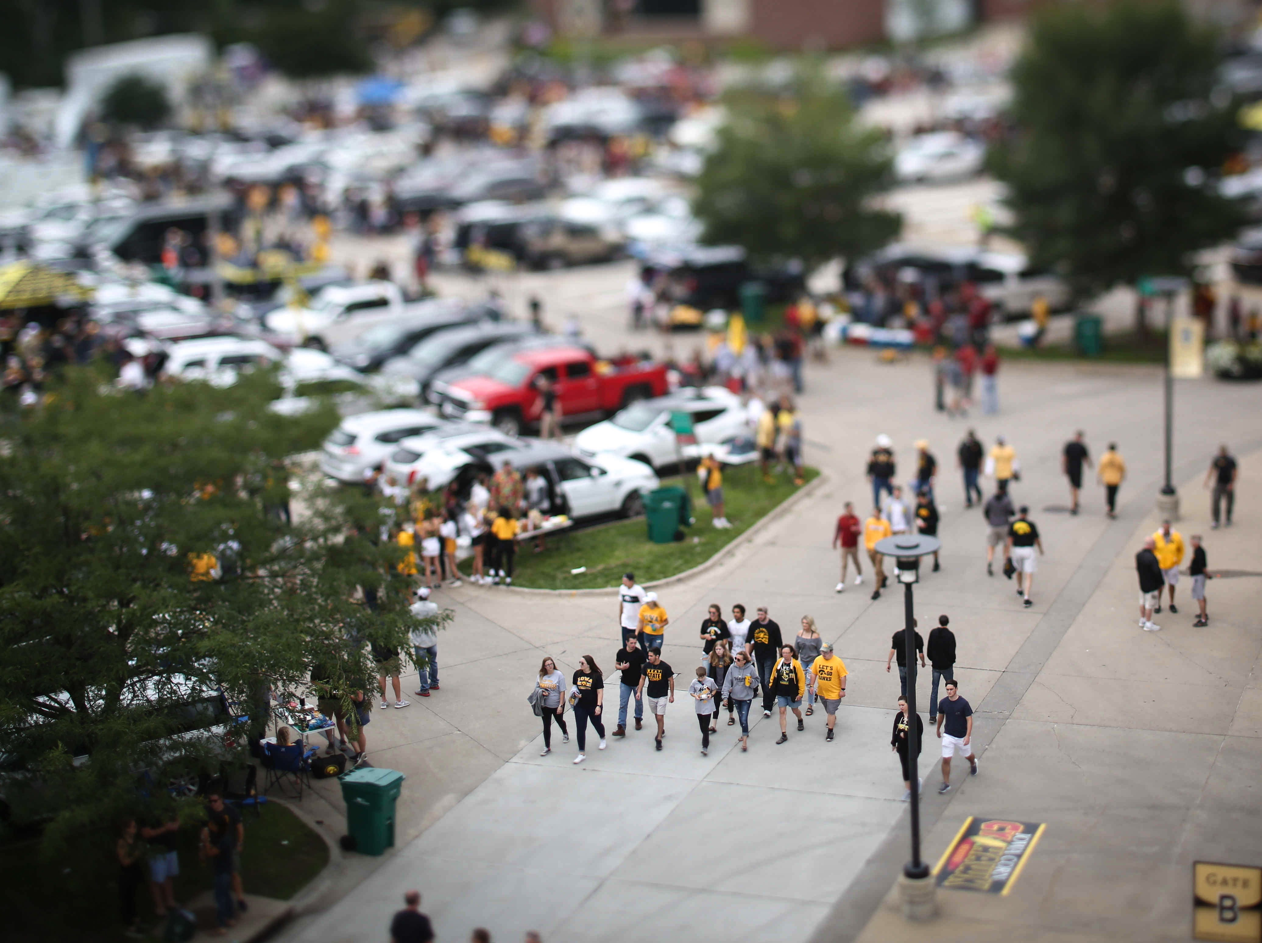 Tailgaters mill about the grounds of Kinnick Stadium during the Cy-Hawk game on Saturday, Sept. 9, 2018, in Iowa City.