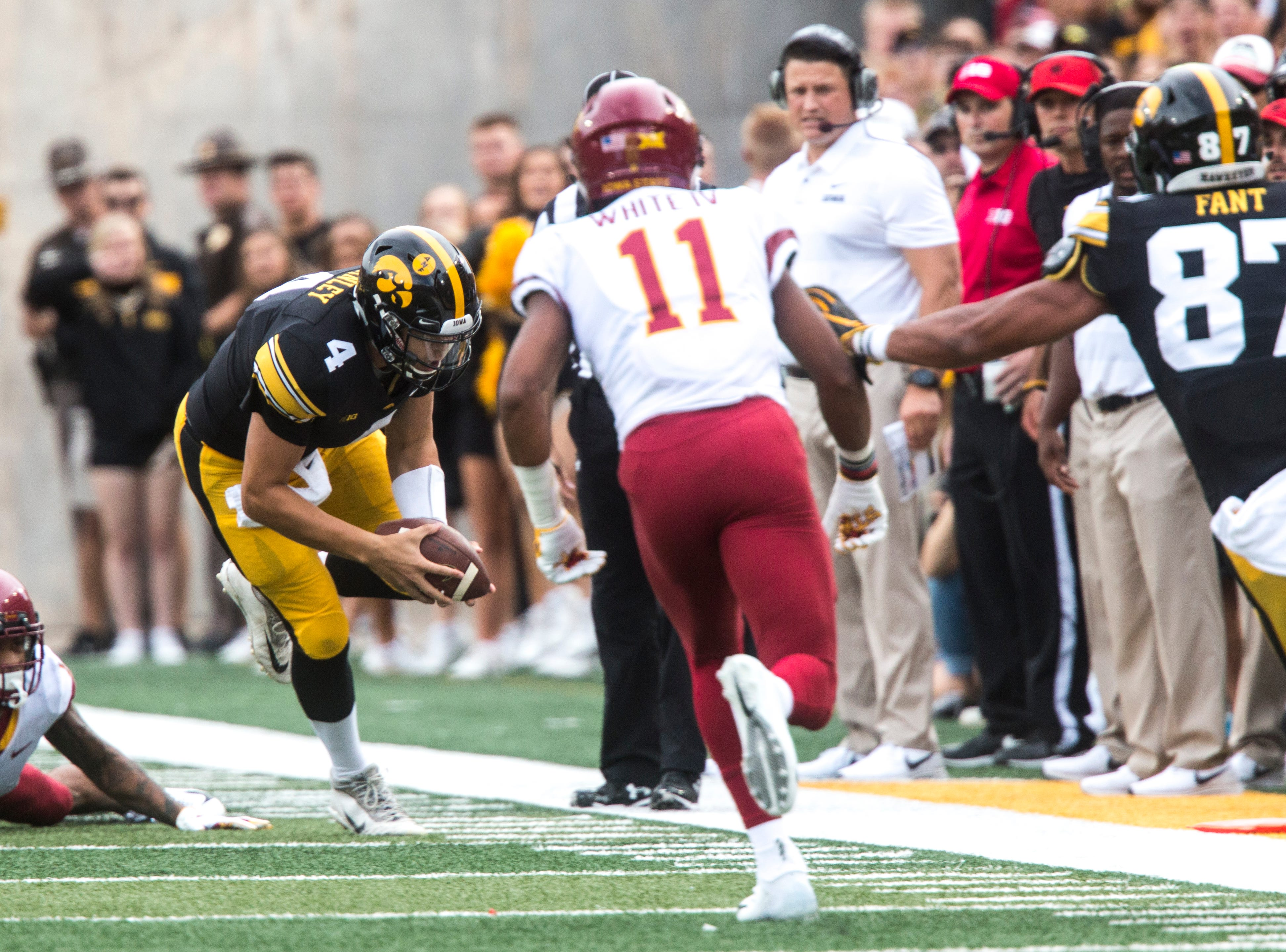 Iowa quarterback Nate Stanley (4) dives towards the side line during the Cy-Hawk NCAA football game on Saturday, Sept. 8, 2018, at Kinnick Stadium in Iowa City.