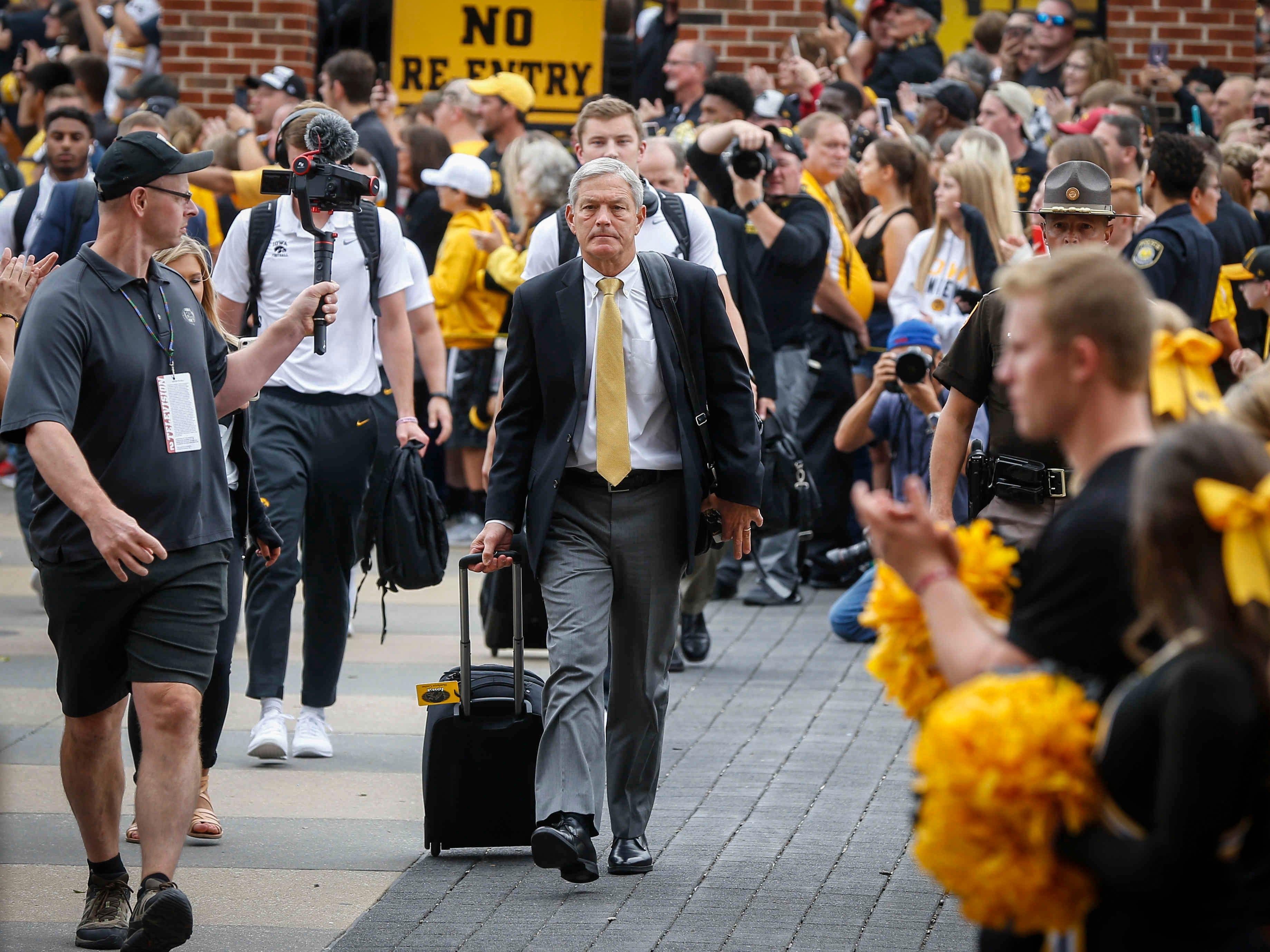 Iowa head football coach Kirk Ferentz makes his walk to the stadium prior to kickoff against Iowa State on Saturday, Sept. 9, 2018, at Kinnick Stadium in Iowa City.