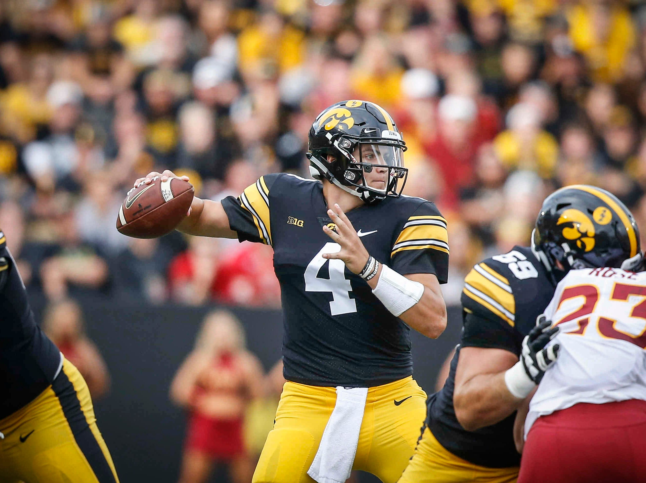 Iowa quarterback Nate Stanley winds back to pass the ball against Iowa State on Saturday, Sept. 8, 2018, at Kinnick Stadium in Iowa City.