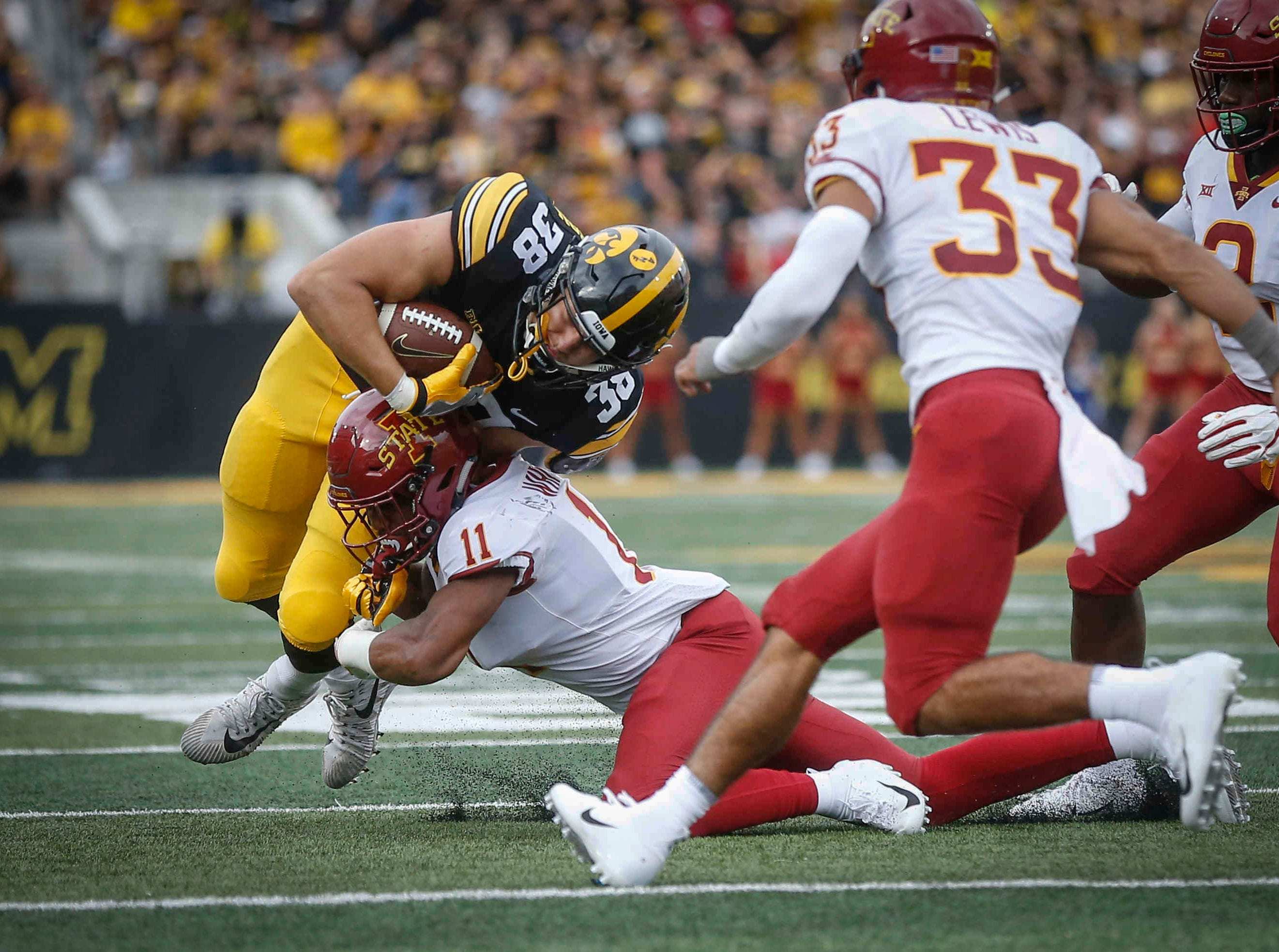 Iowa State defensive back Lawrence White hits Iowa tight end T.J. Hockenson on Saturday, Sept. 8, 2018, at Kinnick Stadium in Iowa City.