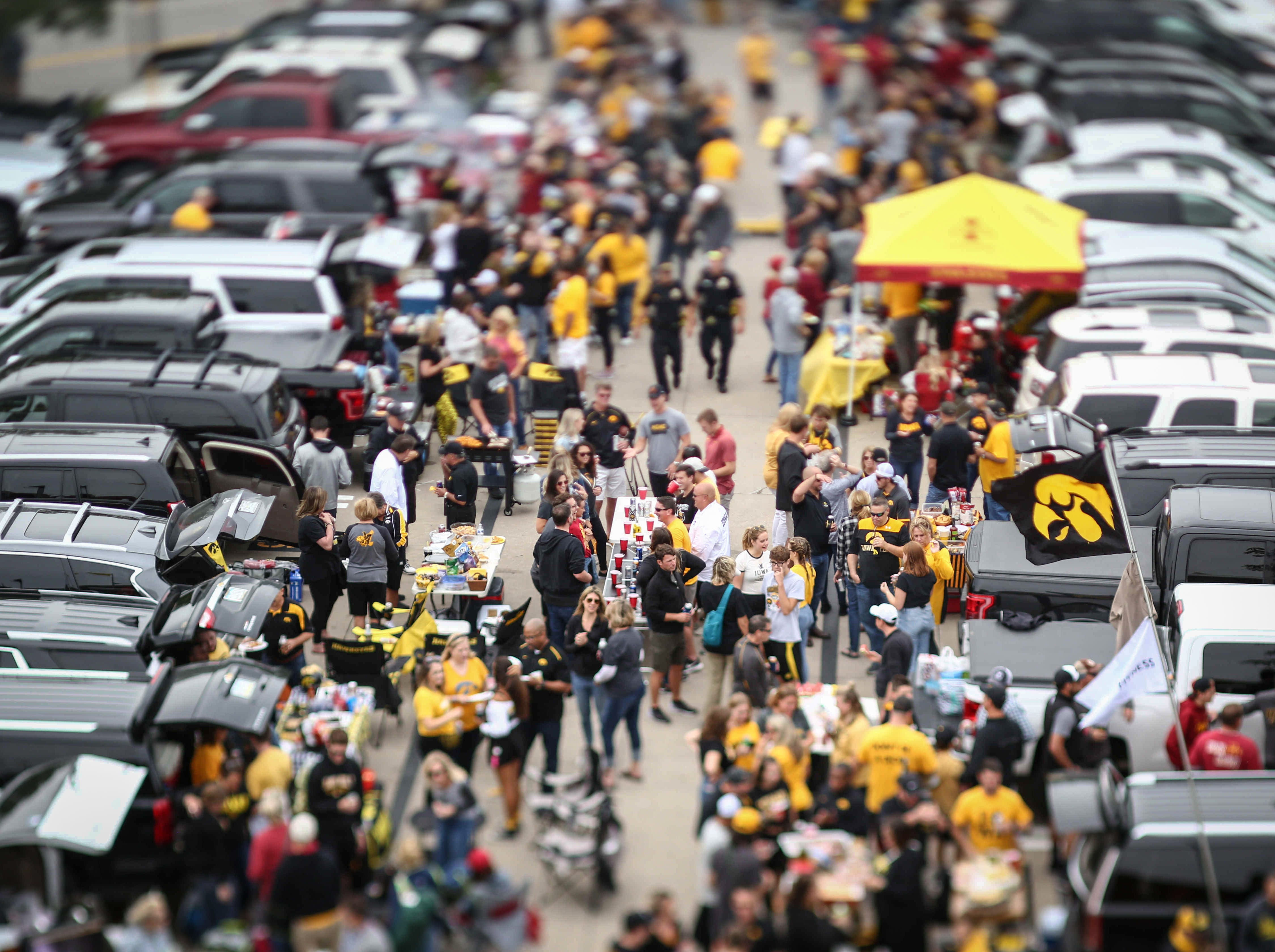 Iowa and Iowa State fans mill about the grounds while tailgating during the CyHawk Series football game on Saturday, Sept. 8, 2018, at Kinnick Stadium in Iowa City.
