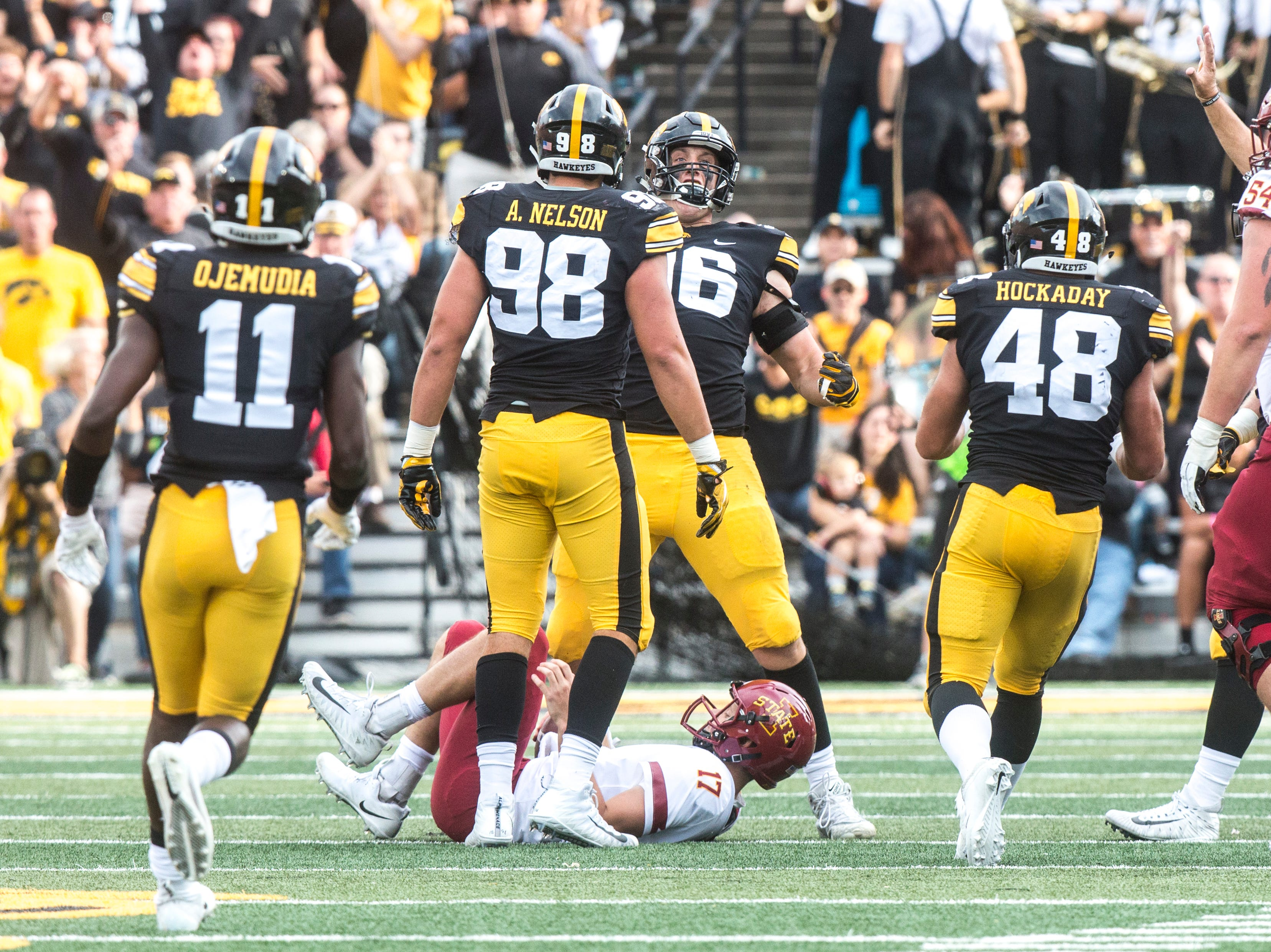 Iowa defensive end Matt Nelson (96) celebrates after sacking Iowa State quarterback Kyle Kempt (17) during the Cy-Hawk NCAA football game on Saturday, Sept. 8, 2018, at Kinnick Stadium in Iowa City.