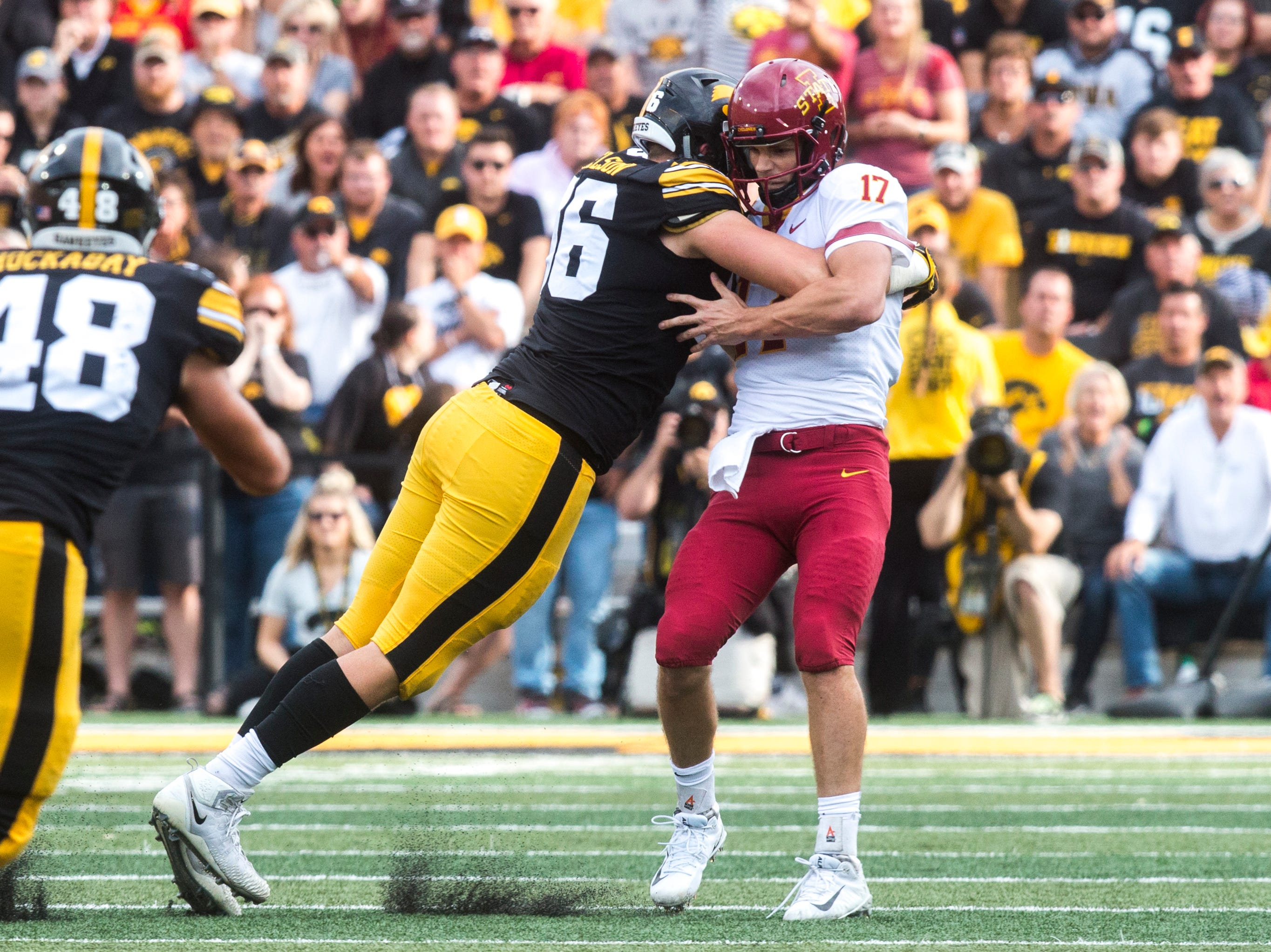 Iowa defensive end Matt Nelson (96) sacks Iowa State quarterback Kyle Kempt (17) during the Cy-Hawk NCAA football game on Saturday, Sept. 8, 2018, at Kinnick Stadium in Iowa City.