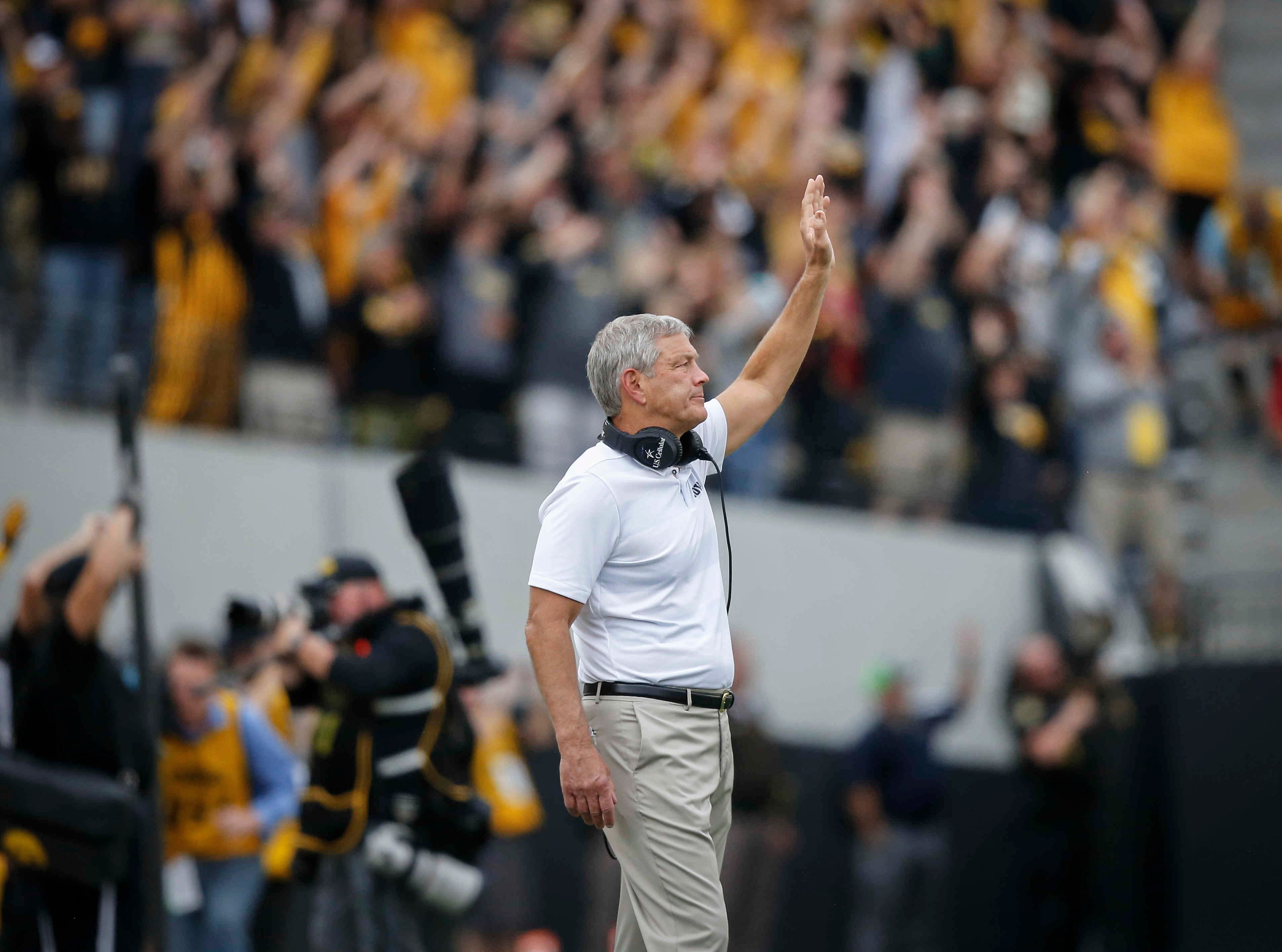 Iowa head football coach Kirk Ferentz waves to the Stead Family Children's Hospital during the first quarter wave against Iowa State on Saturday, Sept. 8, 2018, at Kinnick Stadium in Iowa City.