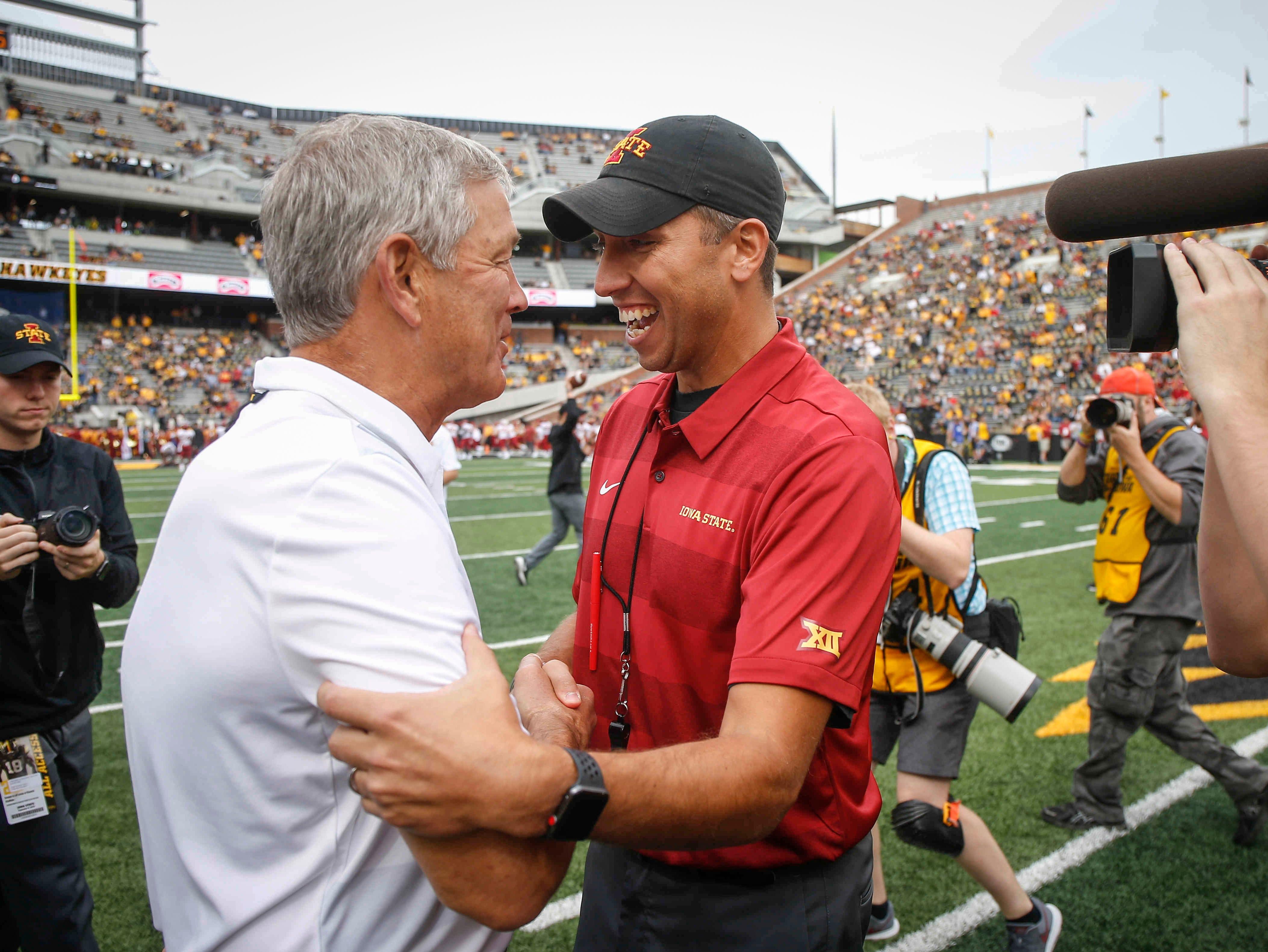 Iowa head football coach Kirk Ferentz, left, meets with Iowa State head football coach Matt Campbell prior to kickoff on Saturday, Sept. 8, 2018, at Kinnick Stadium in Iowa City.