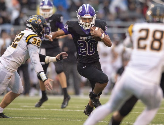 Brownsburg High School junior Donny Marcus (20) rushes the ball out of the backfield en route to the end zone to score during the first half of action. Brownsburg High School hosted Avon High School in IHSAA varsity football action, Friday, Sept. 7, 2018.