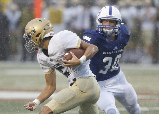 Cathedral's Bo Sanders works past Bishop Chatard's Max Schrage in the first half of the game at Arsenal Tech in Indianapolis, Ind., Friday, Sept. 7, 2018. Bishop Chatard defeated Cathedral 17-14.