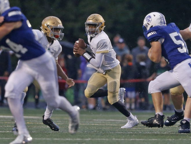 Cathedral's Orin Edwards looks for an open man in the first half of the game against Bishop Chatard at Arsenal Tech in Indianapolis, Ind., Friday, Sept. 7, 2018. Bishop Chatard defeated Cathedral 17-14.