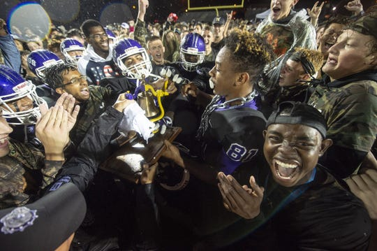 Brownsburg players and fans celebrate with the B & O Bell after defeating Avon. Brownsburg High School hosted Avon High School in IHSAA varsity football action, Friday, Sept. 7, 2018. Brownsburg won 21-7.