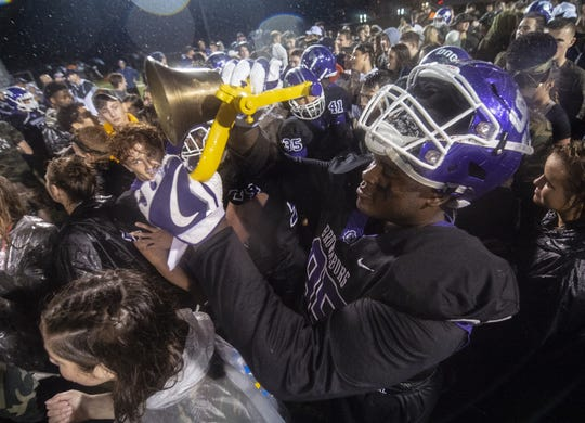 Brownsburg High School junior Dane Middlebrook (95) and fans celebrate with the B & O Bell after defeating Avon. Brownsburg High School hosted Avon High School in IHSAA varsity football action, Friday, Sept. 7, 2018. Brownsburg won 21-7.