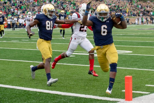 Sep 8, 2018; South Bend, IN, USA; Notre Dame Fighting Irish running back Tony Jones Jr. (6) scores a touchdown in the second quarter against the Ball State Cardinals at Notre Dame Stadium. Mandatory Credit: Matt Cashore-USA TODAY Sports