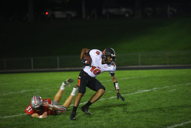Ames' Tamin Lipsey evades City High's Liam McComas during their game at City High on Friday, Sept. 7, 2018.
