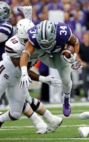 Kansas State running back Alex Barnes (34) is tackled by Mississippi State linebacker Erroll Thompson (40) during the first half of an NCAA college football game Saturday, Sept. 8, 2018, in Manhattan, Kan. (AP Photo/Charlie Riedel)