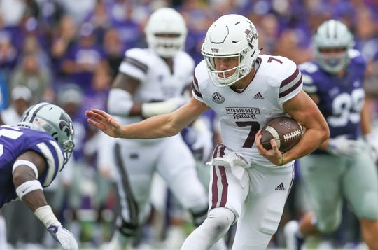 Mississippi State's Nick Fitzgerald (7) gives a stiff arm to a Kansas State defender in the first half. Mississippi State and Kansas State played in a college football game on Saturday, September 8, 2018, in Manhattan, Kansas. Photo by Keith Warren/Madatory Photo Credit